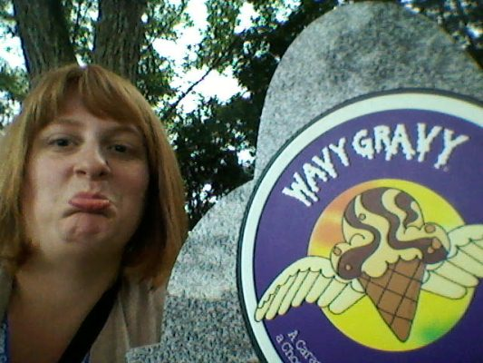 "The author makes a sad face next to the ""grave"" of Wavy Gravy."